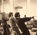 Slide: Four men moving equipment into the Glasgow Print Studio, Ingram Street