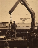 Slide: Printing press being lifted by crane