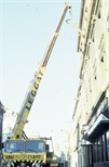 Slide: Exterior view of lithography press being moved out of Glasgow Print Studio, Ingram Street