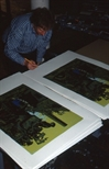 Slide: Peter Howson signing screenprints