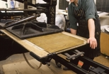 Slide: Woodblock being put through a Colombian press