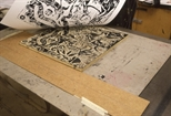 Slide: Print being pulled off woodblock