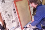 Slide: Harry Magee preparing to coat a screen with photo emulsion