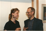 Photograph: Two People Talking at 'Touchstones' Exhibition Opening (1990)
