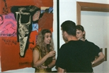 Photograph: Three People Talking at 'Touchstones' Exhibition Opening (1990)