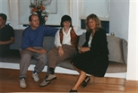Photograph: Three People Sitting at 'Touchstones' Exhibition Opening (1990)