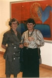 Photograph:Two Women Standing at 'Touchstones' Exhibition Opening (1990)