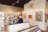 Photograph: Interior of Print Studio Shop with Man and Woman (1992)