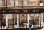 Photograph: Close Up of Exterior of Original Print Shop with Man (1992)
