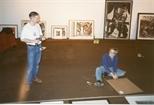 Photograph: John Mackechnie Installing Unique and Original at the Barbican (1992)