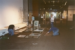 Photograph: John Mackechnie and Others Installing Unique and Original at the Barbican (1992)