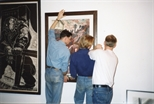 Photograph: Work by Peter Howson Being Installed at Unique and Original at the Barbican (1992)