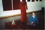 Photograph: Veronique Chance sitting in front of her sculpture 'Evening Gown' (1994)