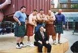 Photograph: Six men posing in front of David Mach sculpture (1994)