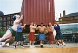 Photograph: Five men posing in front of David Mach sculpture (1994)