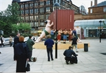 Photograph: Five men being photographed in front of David Mach sculpture (1994)