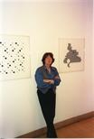 Photograph: Bridget Riley standing between 2 of her works (1996)