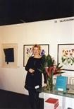 Photograph: Leona Stewart at the Glasgow Print Studio 'Art 97' stand (1997)