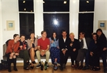 Photograph: Large group posing for photograph at John Taylor's exhibition 'John Taylor - Walking on the Beach and Other Paintings' (1998)