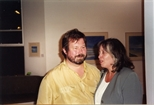 Photograph: A couple at the opening of John Taylor's exhibition 'John Taylor - Walking on the Beach and Other Paintings' (1998)