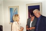 Photograph:3 people in Glasgow Print Studio Gallery during the opening of the John Taylor exhibition 'John Taylor - Walking on the Beach and Other Paintings' (1998)