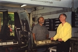 Photograph: John McKechnie and an unknown man standing in the workshop at Arts Acre in Calcutta (1998)
