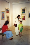 Photograph: 2 women and a child in The Queens Gallery in New Delhi