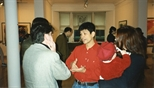 Photograph: Hock Aun Teh speaking to several unknown people at his exhibition at the Glasgow Print Studio Gallery (1997)��