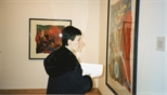 Photograph: An unknown woman viewing the Hock Aun Teh exhibition at Glasgow Print Studio Gallery (1997)