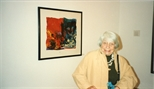 Photograph: An unknown older lady posing with a Hock Aun Teh print in Glasgow Print Studio Gallery (1997)