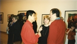 Photograph: Hock Aun Teh at his exhibition at Glasgow Print Studio Gallery, speaking with several people (1997)