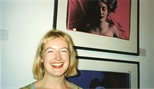 Photograph: Leona Stewart posing with Ashley Cook's print which is an image of Leona herself (1997)