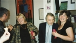 Photograph: Ashley Cook and several unknown other people at her joint exhibition with Janie Nicoll at the Glasgow Print Studio shop (1997)