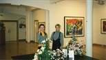 Photograph: 2 unknown women standing in Glasgow Print Studio Gallery during the Hock Aun Teh exhibition (1997)