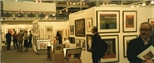 Photograph: Various people viewing the Glasgow Print Studio stand at 'Art 97' in London (1997)