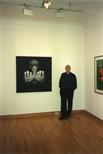 Photograph: Tim Mara with his print 'Chandelier II' (1997)