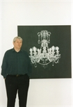 Photograph: A close up view of Tim Mara with his print 'Chandelier II' (1997)