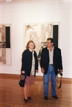Photograph: Jean Yves Langlois with an unknown woman standing in the Glasgow Print Studio during the artist's exhibition (1997)