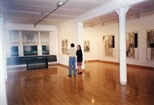 Photograph: Jean Yves Langlois with an unknown woman viewing the artist's work in Glasgow Print Studio gallery (1997)