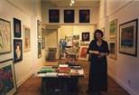 Photograph: Sue MacKechnie in the Glasgow Print Studio Festival shop as part of the Edinburgh Festival (1997)