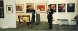 Photograph: Leona Stewart and 3 unknown people at the Glasgow Print Studio stand at Art 1997 Chicago (1997)