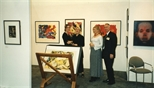 Photograph: 2 unknown women with Leona Stewart and John MacKechnie at the Glasgow Print Studio stand at Art 1997 Chicago (1997)