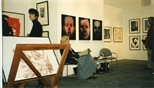 Photograph: Leona Stewart sitting at the Glasgow Print Studio stand at Art 1997 Chicago (1997)