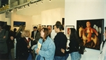 Photograph: Various people milling and viewing the Glasgow Print Studio stand at Art 1997 Chicago (1997)