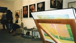 Photograph: Sue MacKechnie sitting in the Glasgow Print Studio stand at Art 1997 Chicago (1997)