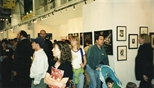 Photograph: A large group of people walking past and viewing the Glasgow Print Studio stand at Art 1997 Chicago (1997)