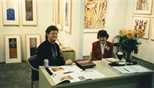 Photograph: A man and woman sitting at an unknown stand at Art 1997 Chicago (1997)