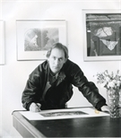 Photograph: John Mackechnie signing a print