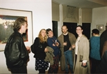 Photograph: A group of people posing for a picture at the opening of the exhibition 'John Taylor - New Work' (1991)