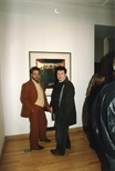 Photograph:2 unknown men at the exhibition 'John Taylor - New Work' at Glasgow Print Studio Gallery (1991)